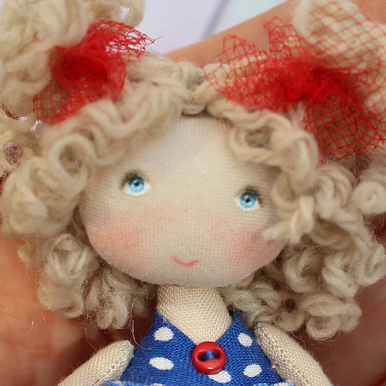 a star small cloth doll to treasure or to offer
