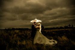 Creative wedding photo in the rain