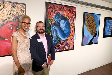 "Carolyn Goodridge and Joel Chalen next to ""Blue boy"""