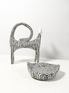 Kattskulptur och skål