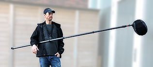 hang your boompole in the boomhanger, attached to an ordinary camera strap en relax