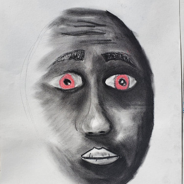 Having a charcoal face with colored eyes is really beautiful.