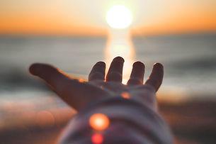 hand sun sea.jpg