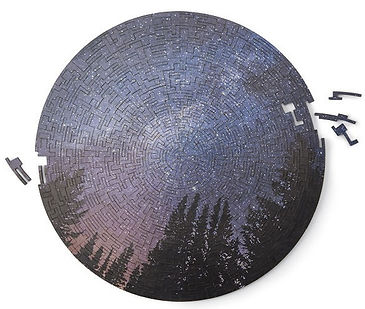 A wooden circular night sky puzzle with