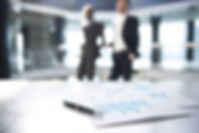 Documents and Blurred Business Men