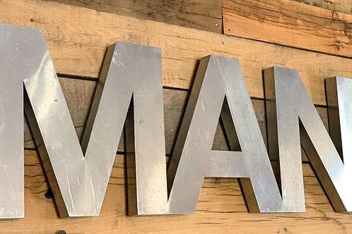 'MAN' sign