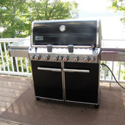 Outside the kitchen is a gas Weber grill for all of your outdoor cooking needs