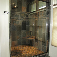 Master multi head, slate tile shower is decadent, spacious & with built in seat
