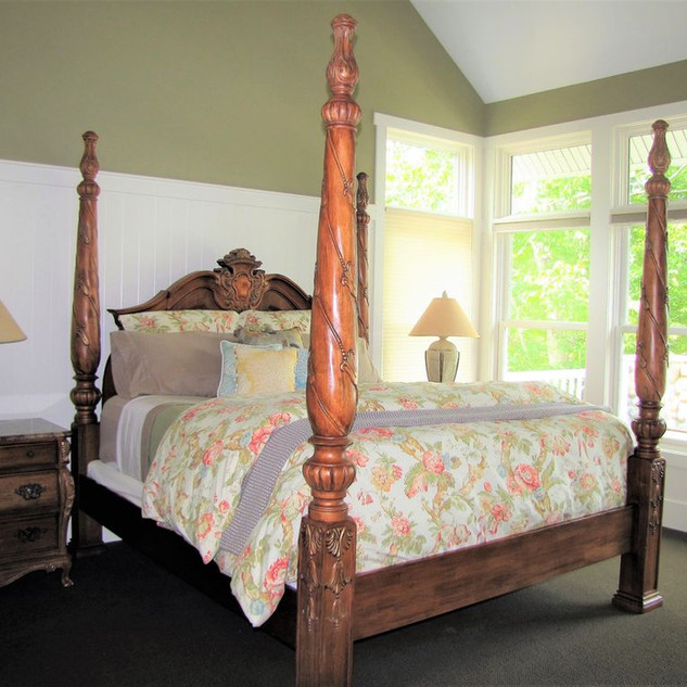 The stately four poster bed, master bedroom, main level, beckens you to relax
