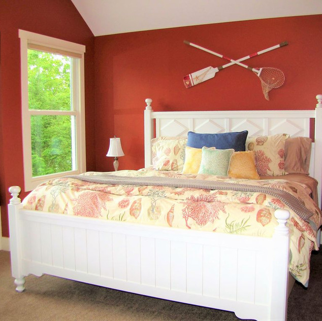 Coastal warmth, the upper level king bedroom has a magnificent view of the lake