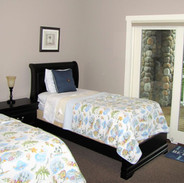 Comfortable twin beds await you, full bath, lower level with direct deck access