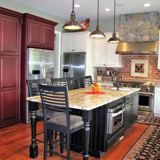Granite countertops and stainless steel appliances in this grand kitchen