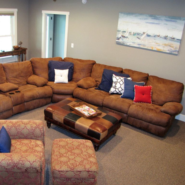 Get comfortable and settle in to viewing big screen TV and movies-lower level