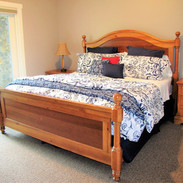Hues of blue & white adorn the king bed, lower level with direct deck access