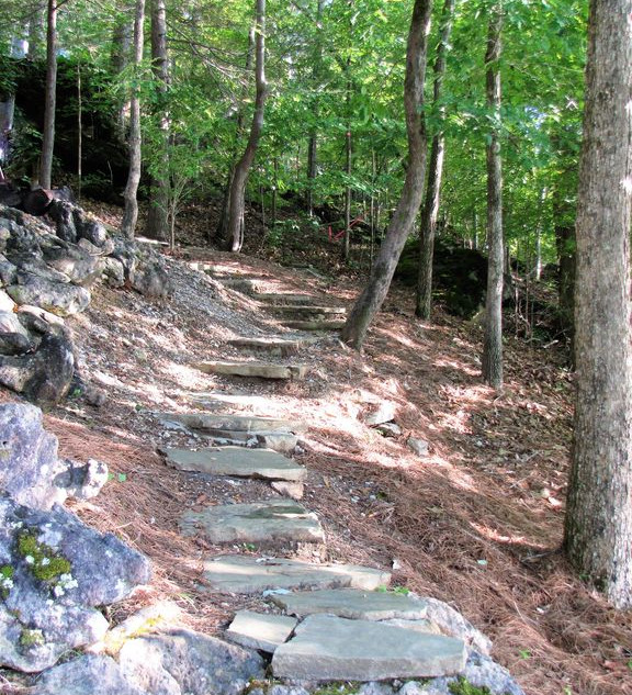 Walk the stone path from the house to the fire pit and the floating dock