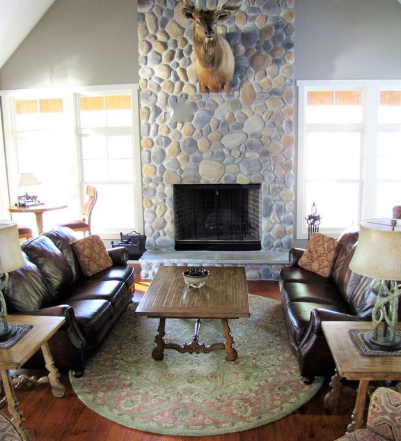 The two story river rock fireplace will keep you warm in the winter