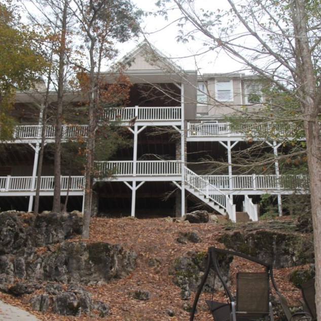 As you approach the house from the lake, it's 5,000 sf plus decks, is grand