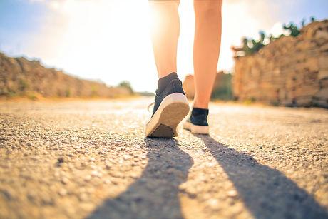 woman-walking-on-pathway-under-the-sun-3