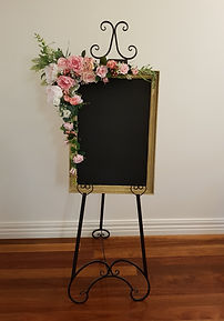 Chalkboard with flowers and easel