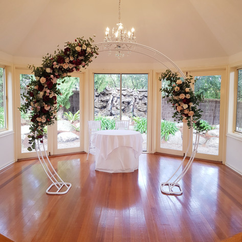 Burgundy floral arch hire.jpg