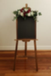 Rustic chalkboard with easel and flowers