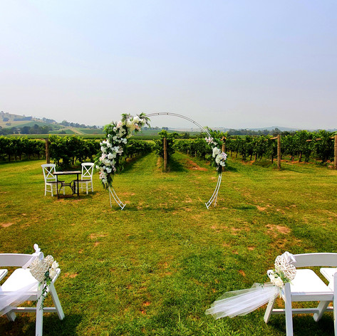 Hire white floral arch.jpg