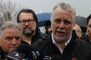 Premier Couillard visits flood victims in Rigaud