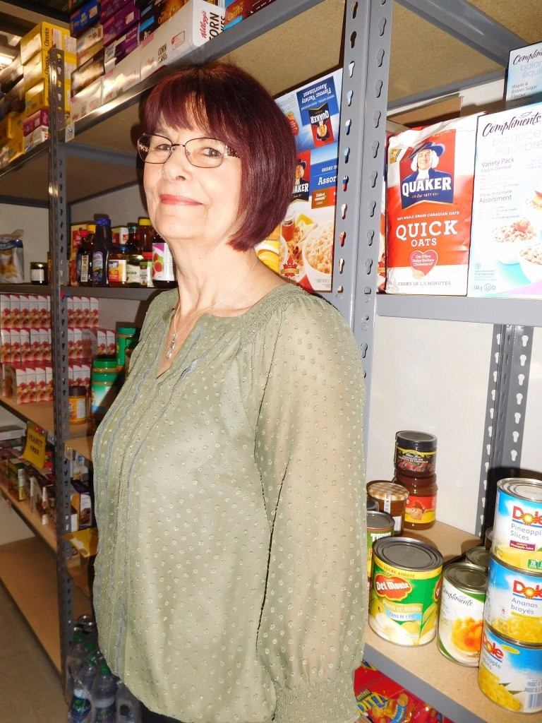 PHOTO BY JAMES PARRY For Hudson's new Irish Queen Mum, Carol Laws, it was volunteer time as usual this week at her Le Pont/Bridging Food Bank.