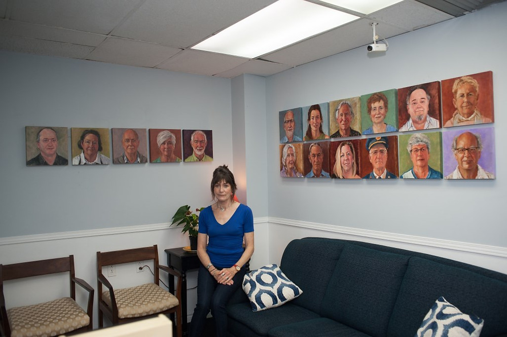 PHOTO COURTESY OF BARBARA CUDDY FARREN Hudson artist, Barbara Cuddy Farren, with just some of her completed portraits to date at Le Chenail Cultural Centre in Hawkesbury.