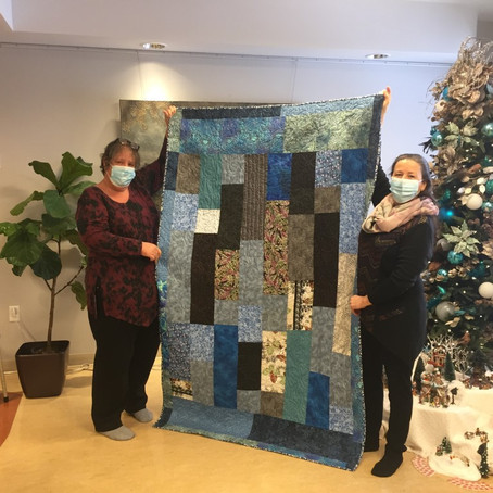Donation from the hand and heart of the Hudson Village Quilters
