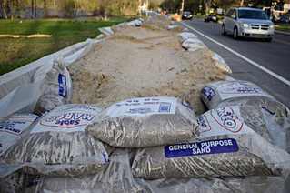 Municipalities have different protocols when disposing of sandbags after flooding