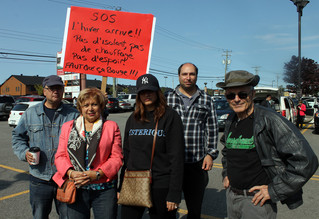 Hundreds rally to protest post-flood treatment