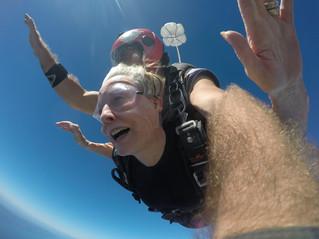 Hudson resident Sandy Lawrence celebrates a perfect landing
