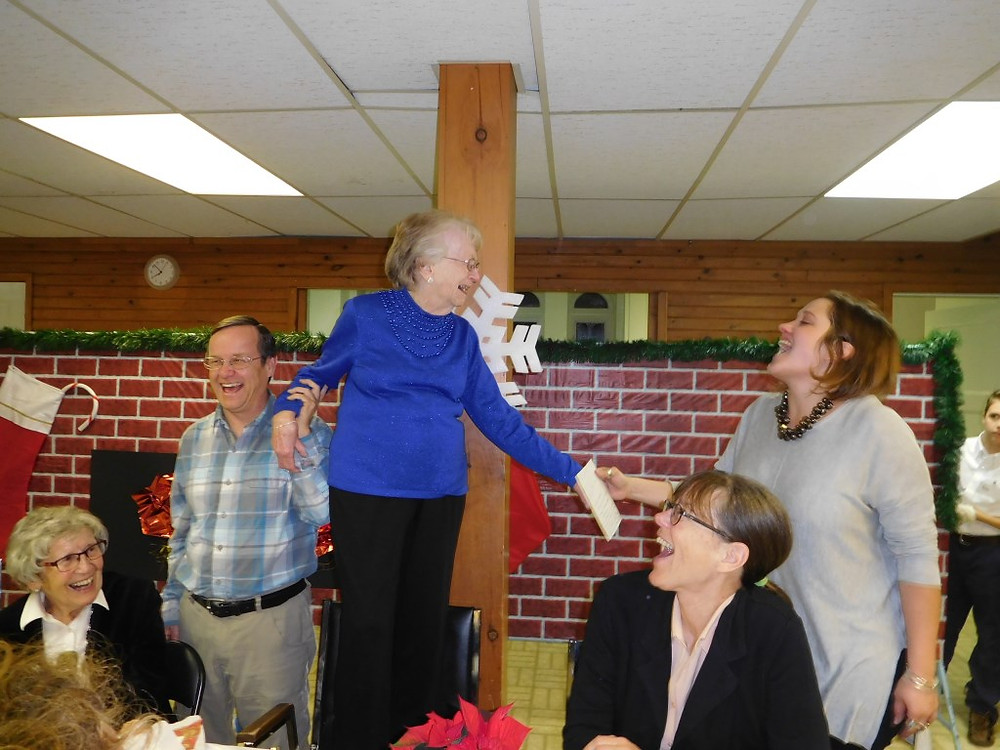 PHOTO BY JAMES PARRY Local songstress Sarah Kemerer (right) serenades Hudsonite Peggy Schutler who turned 90 years young on Saturday, November 26, and who jumped up on a chair as the second sitting of Wyman's turkey dinner that very evening broke out in spontaneous applause.