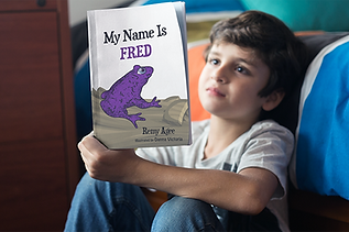 boy reading fred book in room.png