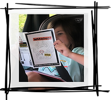 niece warning book in car with frame.png
