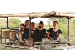 Volunteers taking photos on drive