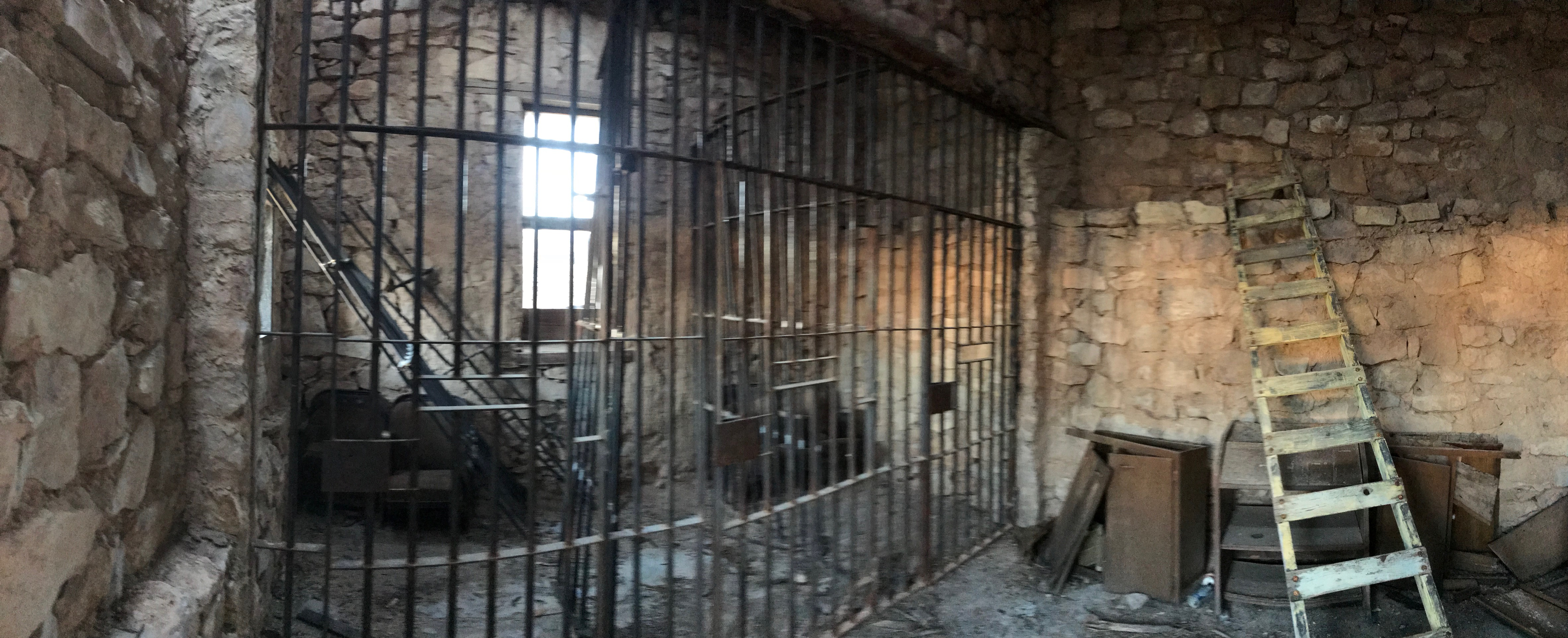 3 jail cells total in rock building