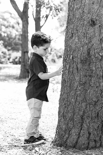 Harrison Photography Christening Boy Next to Tree