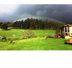 Rainbow over Atma Darshan.png