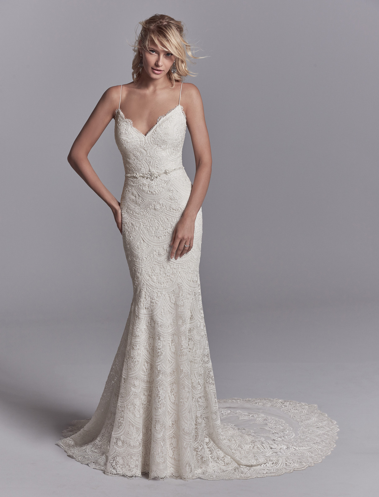 0289c72bf7b Allover lace motifs drift over tulle and Inessa Jersey in this sexy  fit-and-flare wedding dress