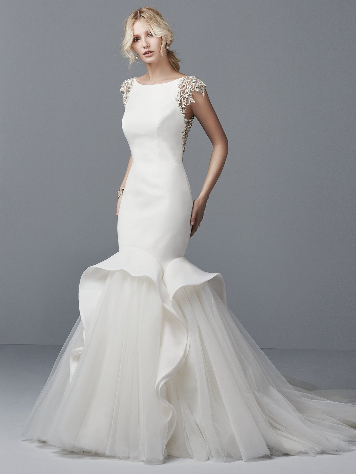 7d4889f63afb ... this Shavon Organza wedding dress features a bateau neckline, with  beaded lace motifs and Swarovski crystals accenting the illusion cap-sleeves  and ...