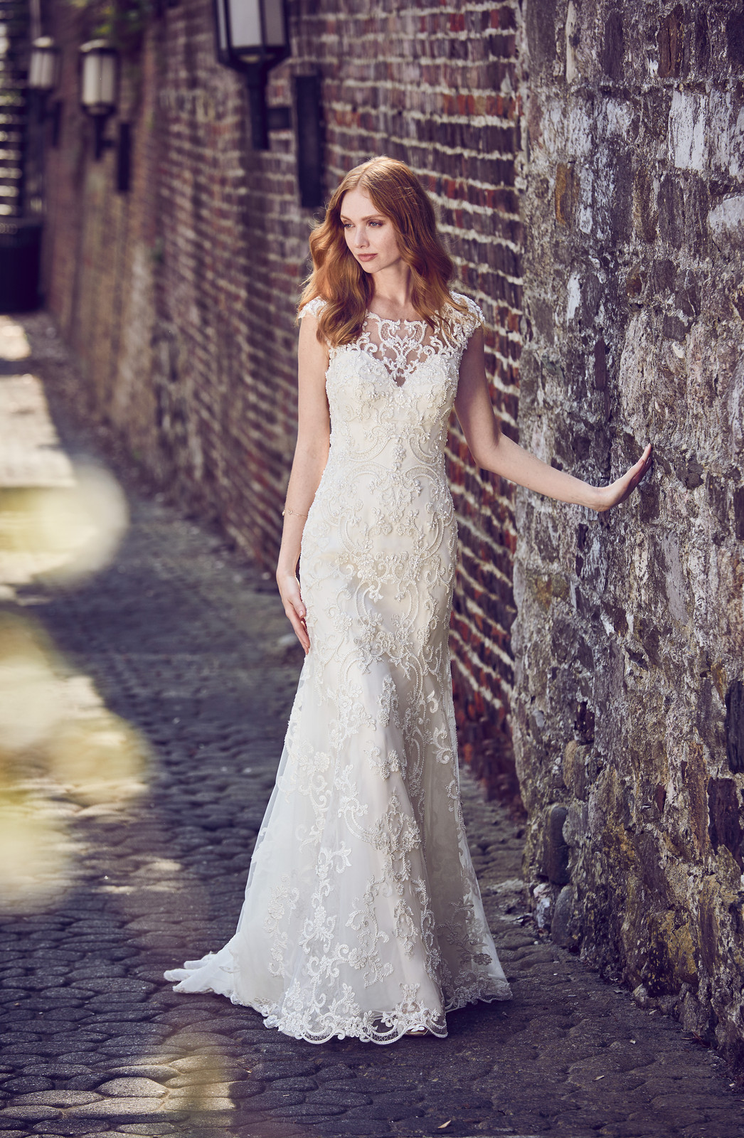 616dfd193ad This elegant fit-and-flare wedding dress features a tulle overlay of beaded  lace motifs