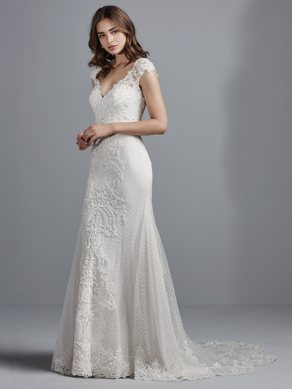 e934d016ff1 This elegant sheath wedding gown features crosshatched tulle