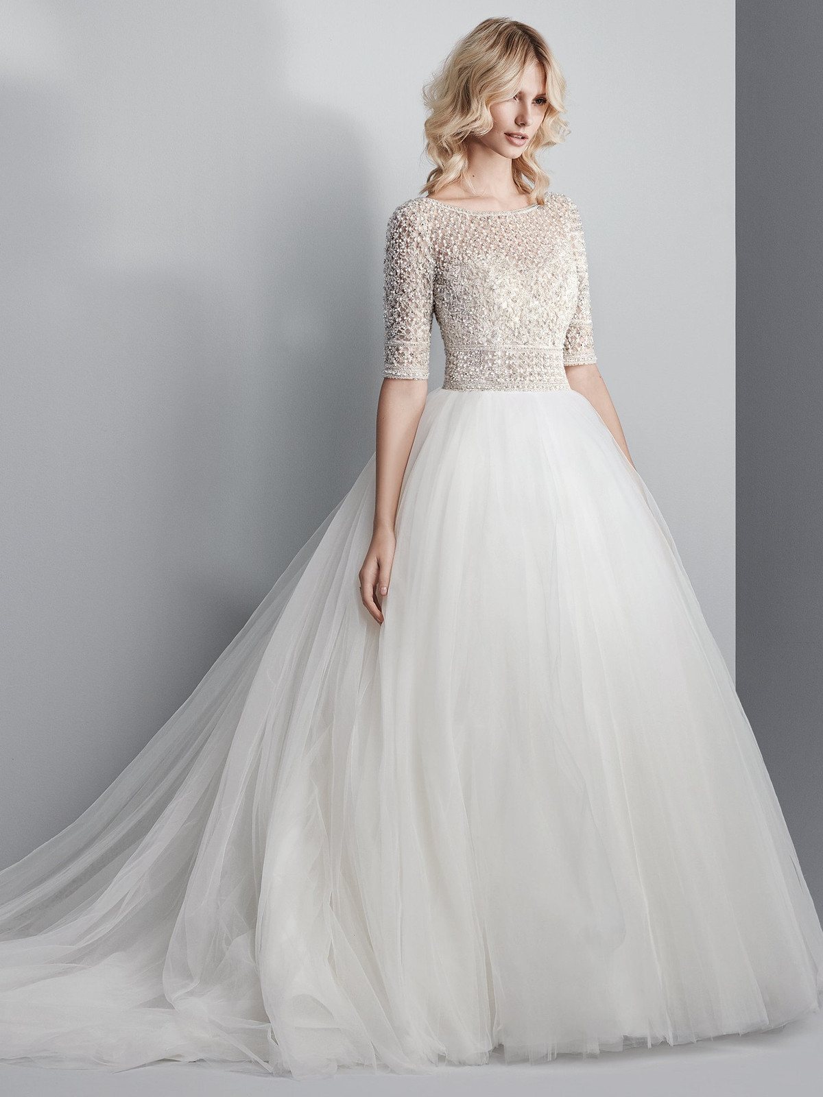 7d165b374 Complete with half-sleeves, an elegant illusion bateau over sweetheart  neckline, and sexy open back.