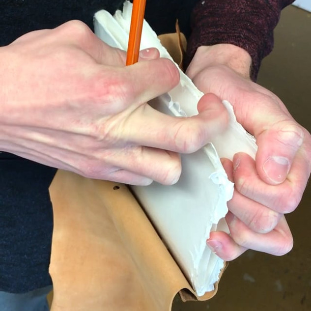 Opening the edges of the folded paper.
