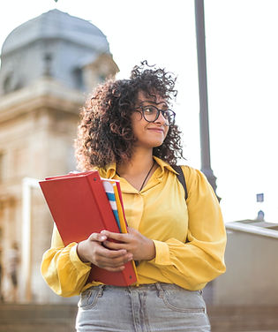 woman-in-yellow-jacket-holding-red-book-