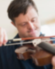 Man with Down Syndrome Playing Violin