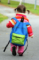 small girl with large backpack