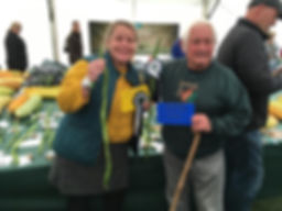 Emily and John with the 2nd and 3rd place awards for the longest runner bean Malvern Show